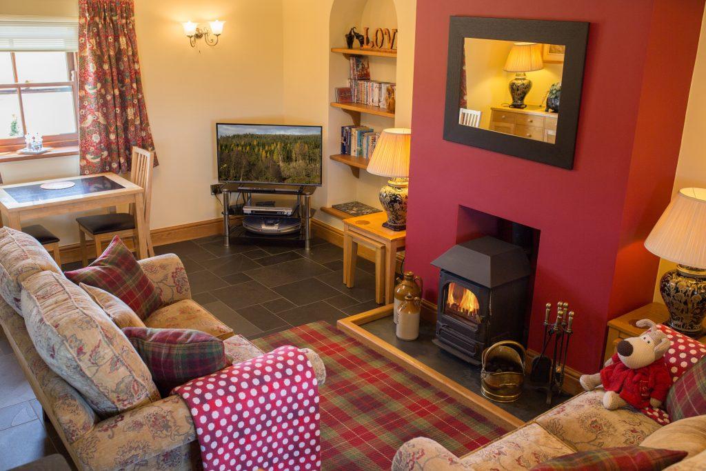 Image of Kearton Lodge living room with fireplace